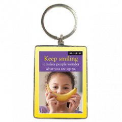 Sleutelhanger M.I.L.K.: Keep smiling it makes people wonder what you are up to.